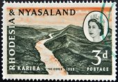 RHODESIA AND NYASALAND - CIRCA 1955: A stamp printed in Rhodesia shows Kariba the gorge