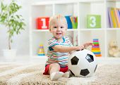 kid boy with football  indoor
