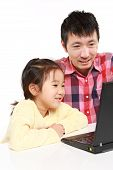 father and daughter on laptop computer
