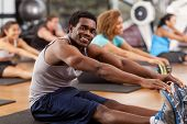 Young African-american Man Stretching In A Gym