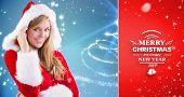 festive blonde smiling at camera against red vignette
