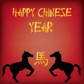 stock photo of chinese new year horse  - a red background with text and a pair of silhouettes of horses for chinese new year - JPG