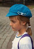 Girl in a blue cap