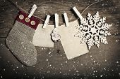 Vintage Christmas decorations and empyty cards hanging on clotheslines