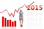 Smiling thoughtful businesswoman against 2015