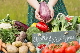 image of farmer  - Healthy New Year against vegetables at farmers market - JPG