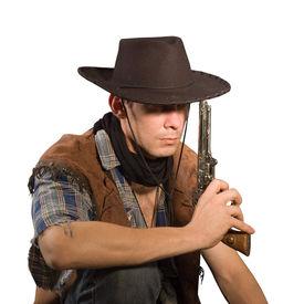 stock photo of wild west  - Cowboy with gun on white background  - JPG