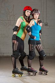 stock photo of roller-derby  - Serious adult female roller derby skaters as friends - JPG