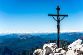 foto of crucifix  - Small iron crucifix on top of a mountain - JPG