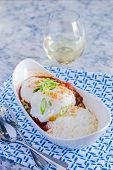 stock photo of loco  - Loco Moco with venison chili rice and a poached egg - JPG