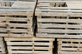 stock photo of wooden crate  - Old wooden crates stacked in natural light - JPG