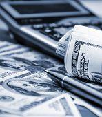 stock photo of ballpoint  - Rolling dollar bills - JPG