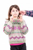 picture of punishment  - Young girl being punished with ear pulling - JPG