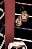 pic of boxing ring  - Vintage gloves hanging in boxing ring corner - JPG