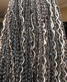 pic of braids  - model with black and light beige colors kanekalon material African braids - JPG