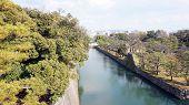 foto of shogun  - canal water and tree landscape around nijo castle in Kyoto Japan - JPG