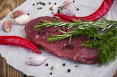 picture of beef shank  - Fresh beef steak with spices on a wooden background  - JPG