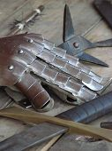 picture of paladin  - equipment from medieval time on the table - JPG