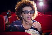 picture of popcorn  - Young man watching a 3d film and eating popcorn at the cinema - JPG