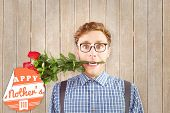 picture of love bite  - Geeky hipster biting a bunch of roses against wooden planks - JPG