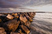 image of jetties  - A jetty on the beach made out of rocks - JPG