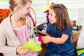 picture of handicrafts  - Kids buying supplies  in handicraft store - JPG
