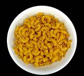 stock photo of elbows  - A white bowl of gluten free elbow pasta on a black background - JPG