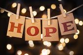 picture of hope  - The word HOPE spelled out on clothespin clipped cards in front of glowing lights - JPG