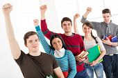 picture of fist  - Group of cheerful students with book - JPG