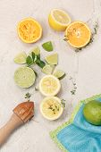 foto of granite  - Still life with citrus fruits and wooden citrus squeezer on granite table - JPG