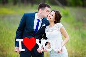 pic of kiss  - Happy groom kissing smiling elegant bride on wedding day - JPG