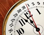 foto of midnight  - Old fashioned clock with the time set at 5 minutes before midnight - JPG