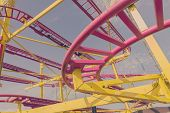foto of carnival ride  - colorful loops of ride close up - JPG
