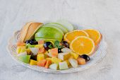 pic of papaya fruit  - Plate full of sliced different kind of fruits selective focus - JPG