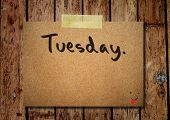 stock photo of tuesday  - Tuesday on note paper with wooden background - JPG