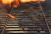 stock photo of ember  - Empty Charcoal Grill With Glowing Embers and Flames Of Fire In The Background - JPG
