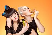 stock photo of junk food  - attractive caucasian girls with unhealthy food - JPG
