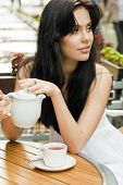 Beautiful woman drinking tea in a cafe