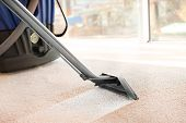 Cleaning service concept. Steam vapor cleaner removing dirt from carpet in flat, closeup poster