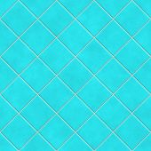 seamless tileable background of turquoise tiles or wall