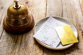Restaurant Bill Paying By Credit Card And Ring On Wooden Table Background poster