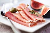 Jamon Serrano with figs and caperberries