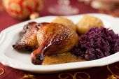 Roast duck legs with potato dumplings and red cabbage for christmas