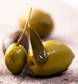 image of greek food  - Marinated greek olives on stone background - JPG