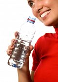 young beautiful smiling girl with mineral water (isolated on white)