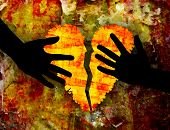 Broken heart & hands on grunge rusty background