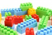 colorful plastic toy bricks close up in studio