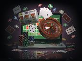 Online casino concept. Laptop with roulette, slot machine, casino chips and playing cards isolated o poster
