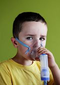 5 years old child taking respiratory, inhalation therapy.
