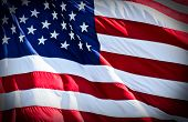 picture of american flags  - an american flag boldly flying in the wind - JPG